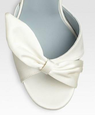 Christian Louboutin white bow shoe